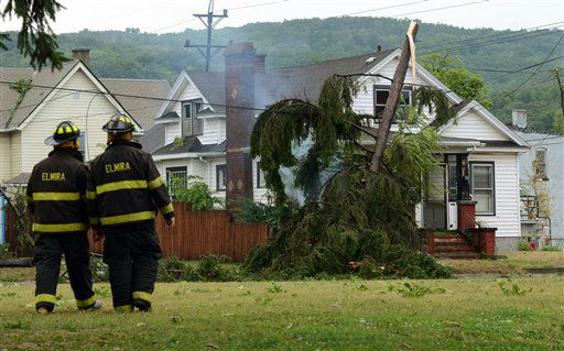 "<div class=""meta ""><span class=""caption-text "">Members of the Elmira Fire Department return to the scene of an electric wire fire after a tornado struck in Elmira, N.Y., Thursday, July 26, 2012. Power lines and trees were toppled and hospitals were placed on disaster alert but there were no immediate reports of injuries after a possible tornado hit the city of Elmira Thursday afternoon, Chemung County Office of Fire and Emergency Management spokeswoman Karen Miner said. (AP Photo/Heather Ainsworth) (AP Photo/ Heather Ainsworth)</span></div>"