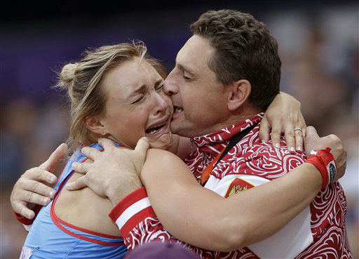 Russia&#39;s Evgeniia Kolodko is embraced by an unidentified man after competing in the women&#39;s shot put during the athletics in the Olympic Stadium at the 2012 Summer Olympics, London, Monday, Aug. 6, 2012. &#40;AP Photo&#47;Anja Niedringhaus&#41; <span class=meta>(AP Photo&#47; Anja Niedringhaus)</span>