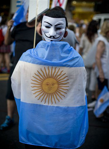 "<div class=""meta image-caption""><div class=""origin-logo origin-image ""><span></span></div><span class=""caption-text"">A protester wearing a mask on the back of his head and an Argentine flag marches during anti government demonstration in Buenos Aires, Argentina, Thursday, Nov. 8, 2012. Thousands of people marched against rising inflation, crime, exchange controls and to express their fear to a constitutional reform that could open the way for a third consecutive reelection of Argentina's President Cristina Fernandez. (AP Photo/Victor R. Caivano) (AP Photo/ Victor R. Caivano)</span></div>"