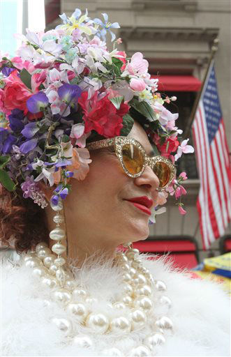 "<div class=""meta image-caption""><div class=""origin-logo origin-image ""><span></span></div><span class=""caption-text"">Dressed for the occasion, Purely Patricia Fox, of New York, poses for photographs on New York's Fifth Avenue as she takes part in the Easter Parade, Sunday, March 31, 2013. (AP Photo/Tina Fineberg) (AP Photo/ Tina Fineberg)</span></div>"