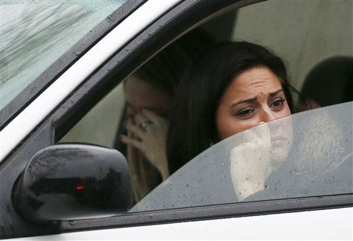 "<div class=""meta ""><span class=""caption-text "">Women react while waiting in a vehicle to drive away from St. Rose of Lima Roman Catholic Church as officials respond to a bomb threat, Sunday, Dec. 16, 2012, in Newtown, Conn. Worshippers hurriedly left the church Sunday, not far from where a gunman opened fire Friday inside the Sandy Hook Elementary School in Newtown. (AP Photo/Julio Cortez) (AP Photo/ Julio Cortez)</span></div>"