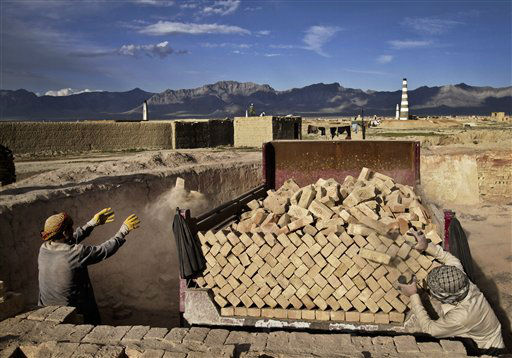 Afghan day laborers work at a local brick factory on the outskirts of Kabul, Afghanistan,  Sunday, April 28, 2013. &#40;AP Photo&#47;Rahmat Gul&#41; <span class=meta>(AP Photo&#47; Rahmat Gul)</span>