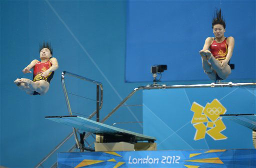 Wu Minxia of China, left, and He Zi compete during the 3 Meter Synchronized Springboard final at the Aquatics Centre in the Olympic Park during the 2012 Summer Olympics in London, Sunday, July 29, 2012. China won the gold medal in the event. &#40;AP Photo&#47;Mark J. Terrill&#41; <span class=meta>(AP Photo&#47; Mark J. Terrill)</span>