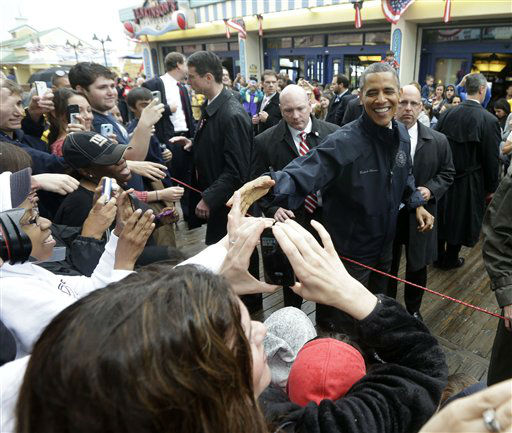 "<div class=""meta ""><span class=""caption-text "">President Barack Obama shakes hands as he visits the boardwalk at Point Pleasant, NJ., Tuesday, May 28, 2013.  Obama traveled to New Jersey to join New Jersey Gov. Chris Christie to inspect and tour the Jersey Shore's recovery efforts from Hurricane Sandy. (AP Photo/Pablo Martinez Monsivais) (AP Photo/ Pablo Martinez Monsivais)</span></div>"