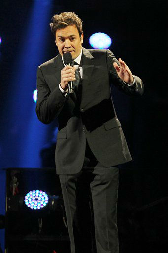 "<div class=""meta image-caption""><div class=""origin-logo origin-image ""><span></span></div><span class=""caption-text"">This image released by Starpix shows Jimmy Fallon at the 12-12-12 The Concert for Sandy Relief at Madison Square Garden in New York on Wednesday, Dec. 12, 2012. Proceeds from the show will be distributed through the Robin Hood Foundation. (AP Photo/Starpix, Dave Allocca) (AP Photo/ Dave Allocca)</span></div>"