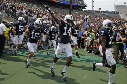 Penn State safety Jordan Lucas &#40;14&#41;  gestures as he runs onto the field for warm ups before an NCAA college football game against Ohio at Beaver Stadium in State College, Pa., Saturday, Sept. 1, 2012. &#40;AP Photo&#47;Gene J. Puskar&#41; <span class=meta>(AP Photo&#47; Gene J. Puskar)</span>