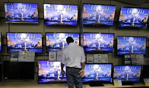 A shopper looks at televisions at a Best Buy store on Friday, Nov. 23, 2012, in Franklin, Tenn., after the store opened at midnight.  Black Friday got off to its earliest start ever as some of the nation&#39;s stores opened Thursday night, beating the traditional Friday opening. &#40;AP Photo&#47;Mark Humphrey&#41; <span class=meta>(AP Photo&#47; Mark Humphrey)</span>