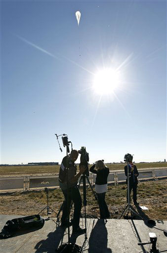 "<div class=""meta ""><span class=""caption-text "">A television crew films the capsule and attached helium balloon, at top of frame, carrying Felix Baumgartner lifting off as he attempts to break the speed of sound with his own body by jumping from a space capsule lifted by a helium balloon, Sunday, Oct. 14, 2012, in Roswell, N.M.  Baumgartner plans to jump from an altitude of 120,000 feet, an altitude chosen to enable him to achieve Mach 1 in free fall, which would deliver scientific data to the aerospace community about human survival from high altitudes.(AP Photo/Ross D. Franklin) (AP Photo/ Ross Franklin)</span></div>"