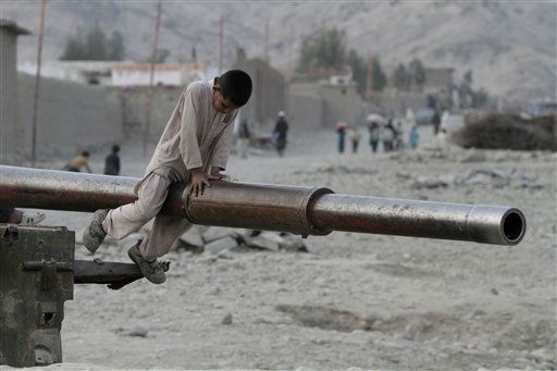 An Afghan child plays on the barrel of a Soviet tank in the Behsood district of Jalalabad, Afghanistan, Monday, Feb 18, 2013. Despite being a mineral-rich country, four decades of war have left Afghanistan as one of the least developed countries in the world and highly dependent on foreign aid. &#40;AP Photo&#47;Rahmat Gul&#41; <span class=meta>(AP Photo&#47; Rahmat Gul)</span>