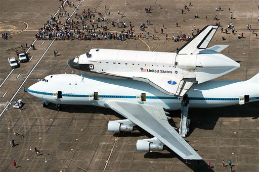 A crowd gathers around the space shuttle Endeavour, carried atop NASA&#39;s 747 Shuttle Carrier Aircraft, after landing at Ellington Field on Wednesday, Sept. 19, 2012, in Houston. Endeavour stopped in Houston on its way from the Kennedy Space Center to the California Science Center in Los Angeles, where it will be placed on permanent display. &#40;AP Photo&#47;Houston Chronicle, Smiley N. Pool, Pool&#41; <span class=meta>(AP Photo&#47; Smiley N. Pool)</span>