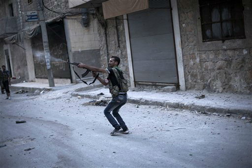 In this Wednesday, Sept. 19, 2012 photo, a Free Syrian Army fighter fires his weapon against Syrian Army positions in the Amariya district in Aleppo, Syria. &#40;AP Photo&#47;Manu Brabo&#41; <span class=meta>(AP Photo&#47; Manu Brabo)</span>