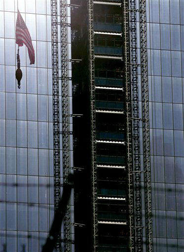 A United States flag hangs from a crane on the side of the construction site of One World Trade Center during the 11th anniversary of the Sept. 11 terrorist attacks, Tuesday, Sept. 11, 2012, in New York. &#40;AP Photo&#47;Julio Cortez&#41; <span class=meta>(AP Photo&#47; Julio Cortez)</span>