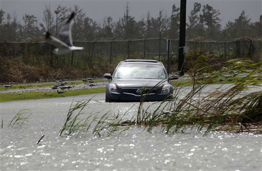 A car sits stranded in rising floodwaters from Isaac, which is expected to make landfall in the region as a hurricane this evening in Venice, La.,  the southernmost tip of the state, Tuesday, Aug. 28, 2012. Venice is outside the storm protection system and has been under mandatory evacuation. Forecasters at the National Hurricane Center warned that Isaac, especially if it strikes at high tide, could cause storm surges of up to 12 feet &#40;3.6 meters&#41; along the coasts of southeast Louisiana and Mississippi and up to 6 feet &#40;1.8 meters&#41; as far away as the Florida Panhandle. &#40;AP Photo&#47;Gerald Herbert&#41; <span class=meta>(AP Photo&#47; Gerald Herbert)</span>