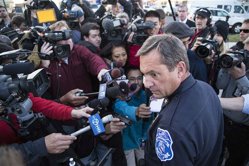 "<div class=""meta ""><span class=""caption-text "">Brookfield Chief of Police Dan Tushaus speaks with reporters in Brookfield, Wis., Sunday , Oct. 21, 2012. The man police suspected of killing three and wounding four by opening fire at a tranquil day spa was found dead following a six-hour manhunt that locked down a shopping center, country club and hospital in suburban Milwaukee. (AP Photo/Tom Lynn) (AP Photo/ Tom Lynn)</span></div>"