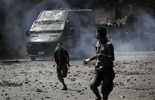"<div class=""meta ""><span class=""caption-text "">Egyptian protesters run during clashes with riot police, background, outside the U.S. embassy in Cairo, Egypt, Thursday, Sept. 13, 2012. Tens were injured in clashes in front of the U.S. embassy in Cairo, the state TV reported on Thursday, quoting Egypt's Health Ministry. (AP Photo/Nasser Nasser) (AP Photo/ Nasser Nasser)</span></div>"