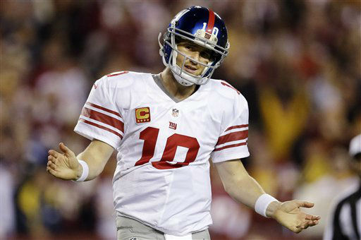 New York Giants quarterback Eli Manning reacts to a play during the second half of an NFL football game against the Washington Redskins in Landover, Md., Monday, Dec. 3, 2012. &#40;AP Photo&#47;Patrick Semansky&#41; <span class=meta>(AP Photo&#47; Patrick Semansky)</span>
