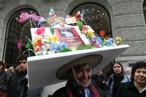Dressed for the occasion, Carmen Garcia, of New York, foreground, poses for photographs on New York&#39;s Fifth Avenue as she takes part in the Easter Parade, Sunday, March 31, 2013. &#40;AP Photo&#47;Tina Fineberg&#41; <span class=meta>(AP Photo&#47; Tina Fineberg)</span>
