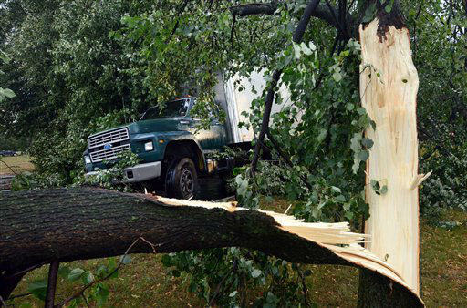 A truck is seen misplaced amid broken trees along E. Church Street after a possible tornado struck the area, Thursday, July 26, 2012, in Elmira N.Y. Power lines and trees were toppled and hospitals were placed on disaster alert but there were no immediate reports of injuries after a possible tornado hit the city of Elmira Thursday afternoon, Chemung County Office of Fire and Emergency Management spokeswoman Karen Miner said.&#40;AP Photo&#47;Heather Ainsworth&#41; <span class=meta>(AP Photo&#47; Heather Ainsworth)</span>