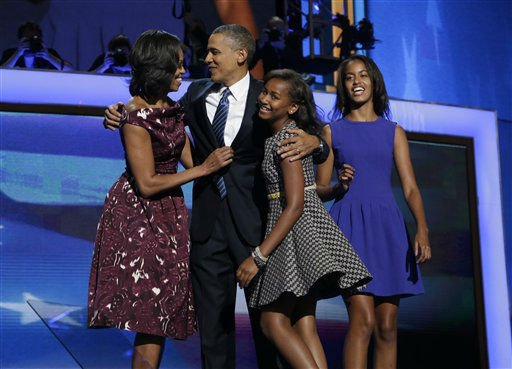 "<div class=""meta image-caption""><div class=""origin-logo origin-image ""><span></span></div><span class=""caption-text"">President Barack Obama, left, is joined on stage by first lady Michelle Obama, left, their children Sasha and Malia, right, on the final day of the Democratic National Convention in Charlotte, N.C., Thursday, Sept. 6, 2012.(AP Photo/Charles Dharapak) (AP Photo/ Charles Dharapak)</span></div>"