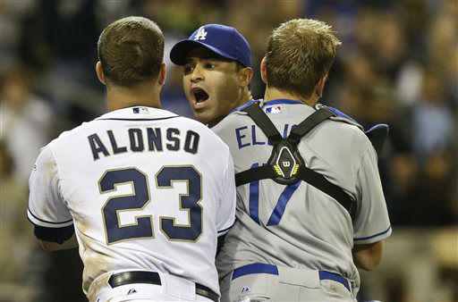 Los Angeles Dodgers&#39; Jerry Hairston Jr. is restrained by A.J. Ellis and San Diego Padres&#39; Yonder Alonso after a braw that had subsided started up again during the sixth inning of baseball game in San Diego, Thursday, April 11, 2013. &#40;AP Photo&#47;Lenny Ignelzi&#41; <span class=meta>(AP Photo&#47; Lenny Ignelzi)</span>