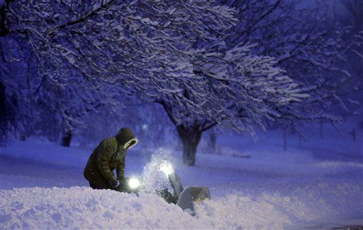 "<div class=""meta ""><span class=""caption-text "">A local resident clears snow from his driveway after an overnight snowfall left many schools and businesses closed for the day, Thursday, Dec. 20, 2012, in Urbandale, Iowa. (AP Photo/Charlie Neibergall) (AP Photo/ Charlie Neibergall)</span></div>"