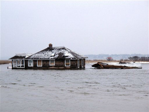 This Feb. 5, 2013, photo,shows a home in the middle of Barnegat Bay, that was washed into the Bay from Mantoloking N.J. during Superstorm Sandy. States hit hard by Sandy are gearing up to remove tons of debris from waterways, including houses, vehicles, sunken boats, furniture, pieces of piers, decks and bulkheads _ all of which must be removed before the summer swimming and boating season. &#40;AP Photo&#47;Wayne Parry&#41; <span class=meta>(AP Photo&#47; Wayne Parry)</span>
