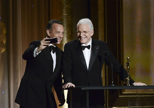 Actor Tom Hanks, left, takes a photo with actor and honoree Steve Martin at the 2013 Governors Awards on Saturday, Nov. 16, 2013 in Los Angeles. &#40;Photo by Dan Steinberg&#47;Invision&#47;AP&#41; <span class=meta>(Photo&#47;Dan Steinberg)</span>