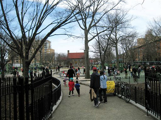This April 7, 2013 image shows people in a playground at Washington Park in the Brooklyn borough of New York. A baseball park was located on the site beginning in the 1880s, and the team, later known as the Brooklyn Dodgers, used the Old Stone House, background center, as a clubhouse. A man named Charles Ebbets worked there as a ticket-taker, eventually took over the team, and later built the Dodgers? storied ballpark at Ebbets Field. A new movie, ?42,? tells the story of Brooklyn Dodger Jackie Robinson, who integrated Major League Baseball and played at Ebbets. &#40;AP Photo&#47;Beth J. Harpaz&#41; <span class=meta>(AP Photo&#47; Beth J. Harpaz)</span>