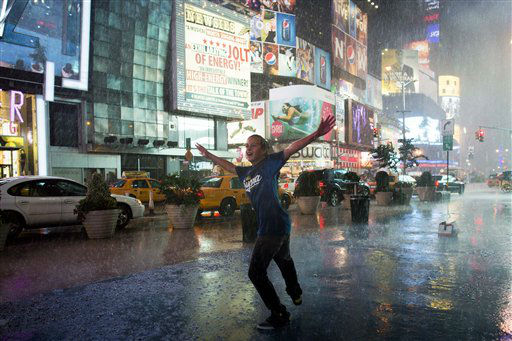 "<div class=""meta ""><span class=""caption-text "">Are Kjeldsberg-Skauby, 12, of Normay, dances in a torrential downpour in Times Square, Thursday, July 26, 2012, in New York. (AP Photo/John Minchillo) (AP Photo/ John Minchillo)</span></div>"