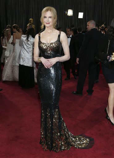 FILE - In a Sunday Feb. 24, 2013 file photo, actress Nicole Kidman arrives at the Oscars at the Dolby Theatre, in Los Angeles wearing a gown by Lwren scott. L&#39;wren Scott launches the limited-edition Banana Republic L?Wren Scott Collection Wednesday, Dec. 4, 2013, and Scott says it will wrap her signature flattering construction and extraordinary fabrics into a package that will cost less than &#36;200. &#40;Photo by Todd Williamson&#47;Invision&#47;AP, File&#41; <span class=meta>(Photo&#47;Todd Williamson)</span>