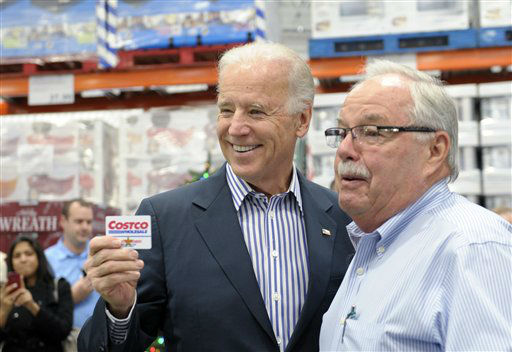 Vice President Joe Biden, standing next to Costco co-founder Jim Sinegal, poses for a photo and shows his Costco membership card as he arrived to shop at the new Costco store in Washington, Thursday, Nov. 29, 2012. Biden went shopping for presents and to highlight the importance of renewing middle-class tax cuts so families and businesses have more certainty at this critical time for our economy. &#40;AP Photo&#47;Susan Walsh&#41; <span class=meta>(AP Photo&#47; Susan Walsh)</span>