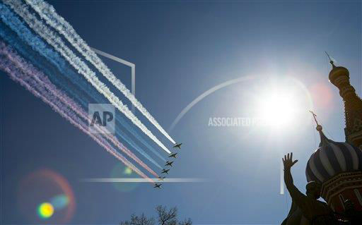 "<div class=""meta ""><span class=""caption-text "">Russian army jet fighters and a cargo plane fly over the Red Square and St. Basil Cathedral, right, during a rehearsal for the Victory Day military parade which will take place at Moscow's Red Square on May 9 to celebrate 68 years of the victory in the WWII, in Moscow, Russia, Tuesday, May 7, 2013.(AP Photo/Alexander Zemlianichenko)  </span></div>"