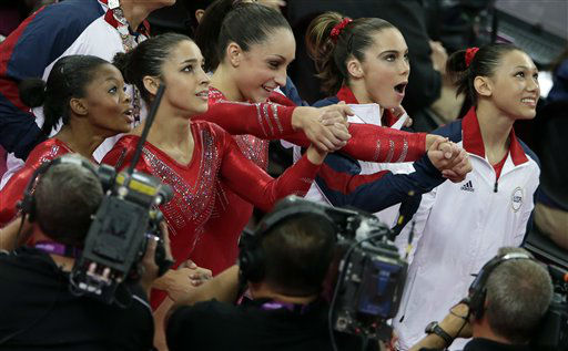 "<div class=""meta ""><span class=""caption-text "">U.S. gymnasts, from left to right, Gabrielle Douglas, Alexandra Raisman, Jordyn Wieber, McKayla Maroney and Kyla Ross react as they watch the screen that displays results declaring them winners of the gold medal during the Artistic Gymnastic women's team final at the 2012 Summer Olympics, Tuesday, July 31, 2012, in London. (AP Photo/Gregory Bull) (AP Photo/ Gregory Bull)</span></div>"