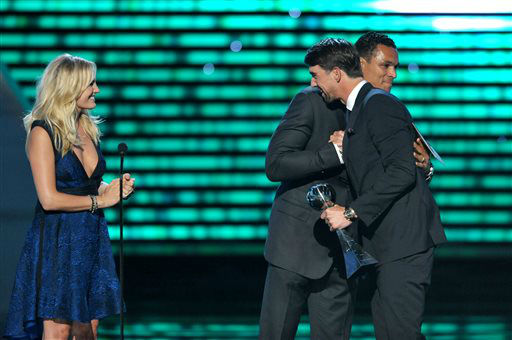 From left, Malin Akerman and Tony Gonzalez present the award for best record-breaking performance to Michael Phelps at the ESPY Awards on Wednesday, July 17, 2013, at Nokia Theater in Los Angeles. &#40;Photo by John Shearer&#47;Invision&#47;AP&#41; <span class=meta>(Photo&#47;John Shearer)</span>