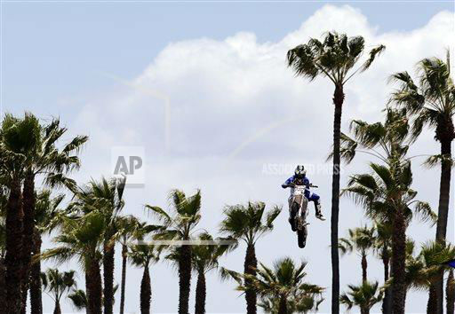 "<div class=""meta ""><span class=""caption-text "">Keith Sayers performs during a Red Bull freestyle motocross demonstration in Venice, Calif., Tuesday, May 7, 2013. (AP Photo/Jae C. Hong)  </span></div>"