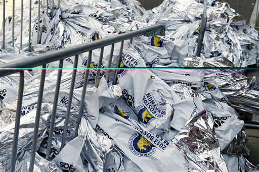 "<div class=""meta ""><span class=""caption-text "">Runners blankets are piled up near the finish line of the Boston Marathon in Boston Tuesday, April 16, 2013. The bombs that ripped through the crowd at the Boston Marathon, killing at least three people and wounding more than 170, were fashioned out of pressure cookers and packed with shards of metal, nails and ball bearings to inflict maximum carnage, a person briefed on the investigation said Tuesday. (AP Photo/Winslow Townson) (AP Photo/ Winslow Townson)</span></div>"