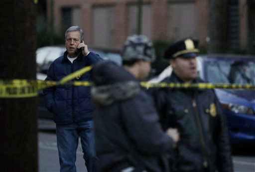 Hoboken Police Chief Anthony P. Falco, Sr., left, talks on the phone in Hoboken, N.J., Friday, Dec. 14, 2012, after local police and the FBI converged on a Hoboken residence near the intersection of 13th and Grand streets after a connection was reported with the shootings at the Sandy Hook Elementary School in Newton, Conn. &#40;AP Photo&#47;Mel Evans&#41; <span class=meta>(AP Photo&#47; Mel Evans)</span>