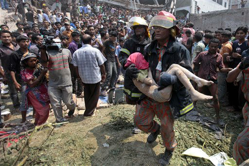 Rescue workers carry a young victim&#39;s body after an eight-story building housing several garment factories collapsed in Savar, near Dhaka, Bangladesh, Wednesday, April 24, 2013. Dozens were killed and many more are feared trapped in the rubble. &#40;AP Photo&#47; A.M. Ahad&#41; <span class=meta>(AP Photo&#47; A.M. Ahad)</span>