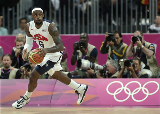 CORRECTS DATE TO SUNDAY, JULY 29, NOT FRIDAY, JULY 27- United States&#39; Lebron James looks up the court during the first half of a preliminary men&#39;s basketball game against France at the 2012 Summer Olympics, Sunday, July 29, 2012, in London. &#40;AP Photo&#47;Charles Krupa&#41; <span class=meta>(AP Photo&#47; Charles Krupa)</span>