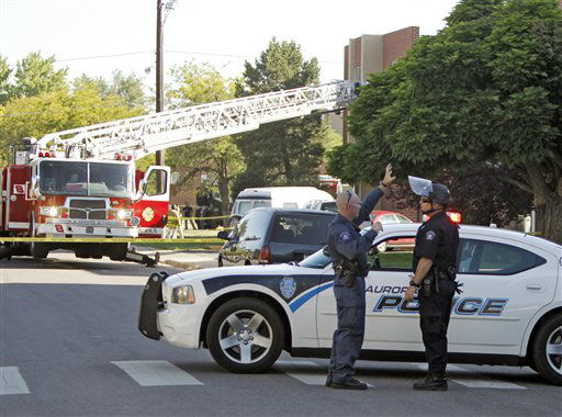 Police block the road in front of  an apartment where the suspect in a theatre shooting lived in Aurora, Colo., on Friday, July 20, 2012. As many as 12 people were killed and 50 injured at a shooting at the Century 16 movie theatre on Friday. The suspect is identified as 24-year-old James Holmes.  &#40;AP Photo&#47;Ed Andrieski&#41; <span class=meta>(AP Photo&#47; Ed Andrieski)</span>
