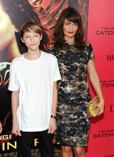 "Helena Christensen and son Mingus Reedus attend a special screening of ""The Hunger Games: Catching Fire"" at AMC Lincoln Square on Wednesday, Nov. 20, 2013 in New York. (Photo by Evan Agostini/Invision/AP)"