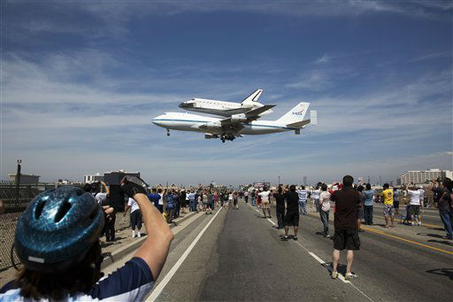 In this photo provided by NASA, the Space Shuttle Endeavour atop a modified 747 lands at Los Angeles International Airport on Friday, Sept. 21, 2012 in Los Angeles. Endeavour will be permanently displayed at the California Science Center in Los Angeles. (AP Photo/NASA, Matt Hedges)