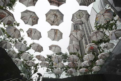 Umbrellas are displayed in front of Seoul City Hall in Seoul, South Korea, Tuesday, July 2, 2013. The display symbolizes Seoul public officials&#39; slogan to be an umbrella or to protect Seoul citizens. &#40;AP Photo&#47;Ahn Young-joon&#41; <span class=meta>(AP Photo&#47; Ahn Young-joon)</span>