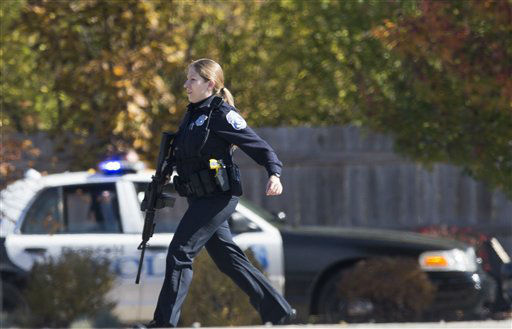 A police officer responds to a call of a shooting at the Azana Spa in Brookfield, Wis. Sunday, Oct. 21, 2012.  Multiple people were wounded when someone opened fire at the spa near the Brookfield Square Mall. Deputies are still looking for the gunman. &#40;AP Photo&#47;Tom Lynn&#41; <span class=meta>(AP Photo&#47; Tom Lynn)</span>