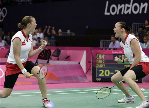 Denmark&#39;s Christinna Pedersen, left, and Kamilla Rytter Juhl celebrate after winning the first game of the women&#39;s doubles badminton match against Tian Qing and Zhao Yunlei of China, at the 2012 Summer Olympics, Tuesday, July 31, 2012, in London. &#40;AP Photo&#47;Andres Leighton&#41; <span class=meta>(AP Photo&#47; Andres Leighton)</span>
