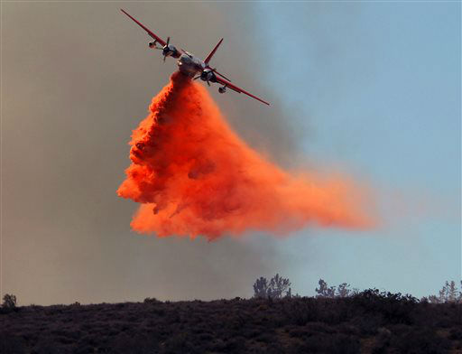 A plane drops fire retardant on a wildfire in Lancaster, Calif., Monday, June 3, 2013. Firefighters working in darkness doubled containment of a massive wildfire north of Los Angeles to 40 percent overnight, as cool, moist air moved in Monday to replace torrid weather. &#40;AP Photo&#47;Nick Ut&#41; <span class=meta>(AP Photo&#47; Nick Ut)</span>