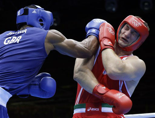 Italy&#39;s Roberto Cammarelle, right, fights Britain&#39;s Anthony Joshua in a super heavyweight over 91-kg gold medal boxing match at the 2012 Summer Olympics, Sunday, Aug. 12, 2012, in London. Joshua won the gold medal and Cammarelle won the silver.  &#40;AP Photo&#47;Patrick Semansky&#41; <span class=meta>(AP Photo&#47; Patrick Semansky)</span>