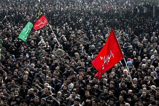Iranian mourners beat their chests, in a ceremony commemorating Arbaeen, the final day of the annual 40-day mourning period for the seventh century martyrdom of Imam Hussein, the grandson of Prophet Muhammad, in Tehran, Iran, Thursday, Jan. 3, 2012. &#40;AP Photo&#47;Vahid Salemi&#41; <span class=meta>(AP Photo&#47; Vahid Salemi)</span>