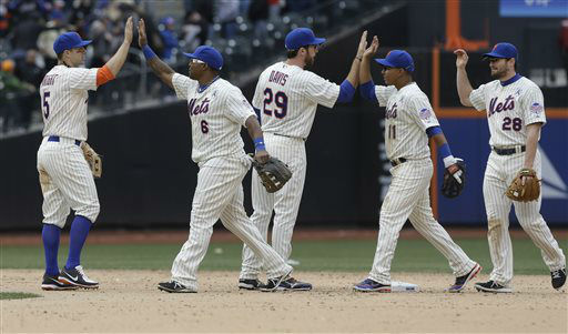 New York Mets&#39; David Wright &#40;5&#41;, Marlon Byrd &#40;6&#41;, Ike Davis &#40;29&#41;, Ruben Tejada &#40;11&#41; and Daniel Murphy &#40;28&#41; celebrate after an opening day baseball game against the San Diego Padres Monday, April 1, 2013, in New York. The Mets won the game 11-2. &#40;AP Photo&#47;Frank Franklin II&#41; <span class=meta>(AP Photo&#47; Frank Franklin II)</span>