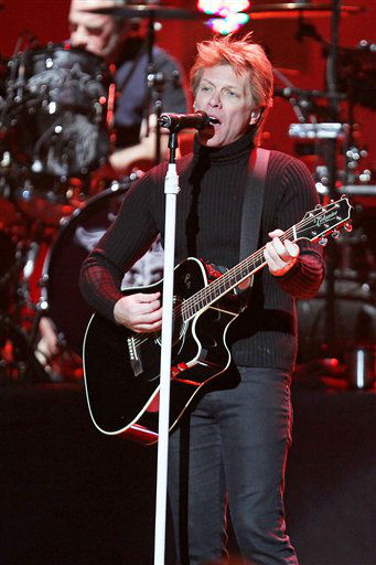 This image released by Starpix shows Jon Bon Jovi performing at the 12-12-12 The Concert for Sandy Relief at Madison Square Garden in New York on Wednesday, Dec. 12, 2012. Proceeds from the show will be distributed through the Robin Hood Foundation. &#40;AP Photo&#47;Starpix, Dave Allocca&#41; <span class=meta>(AP Photo&#47; Dave Allocca)</span>
